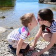 Foto de Stock  : Children brother and sister kiss on the beach