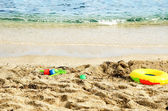 Children's toys on the beach close-up — Stock Photo