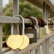 Lock hangs on a lattice bridge — Stock Photo