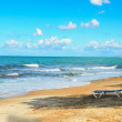 Lonely chaise lounge on the beach — Stock Photo #36721055