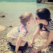 Photo: Children brother and sister kiss on the beach toning vanilla eff