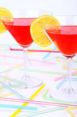 Two glasses with red cocktail front vertical — Stock Photo