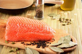 Salmon fillet on a cutting board on the table — Stock Photo