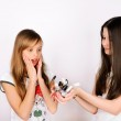 Teen girl shows her friend a lot of bottles of nail polish — Stock Photo #45202043