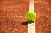 Tennis ball is on the markup horizontal — Stock Photo