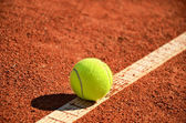Tennis ball is on the markup diagonal horizontal — Stock Photo