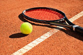 Tennis ball and racket is on the carpet court horizontal — Stock Photo