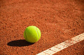 Tennis ball near markup diagonal horizontal — Stock Photo