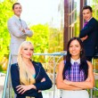 Stockfoto: Portrait of four business people
