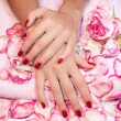 Woman hands with red manicure — Stock Photo