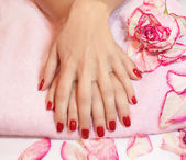 Young woman hands with red manicure — Stock Photo