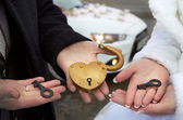 Love padlocks in hands — Stock Photo