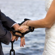 Chain and hands - Symbol of love — Stock Photo