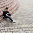 Man sitting on the steps — Stock Photo