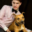 Teen with dog Staffordshire Terrier — Stock Photo #40009017