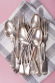 Vintage cutlery on a kitchen towel — Stock Photo