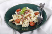 Fusilli with white cream sauce — Stock fotografie