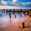 Long exposure at sunset of pier pilings in the Delaware Bay at S — Stock Photo