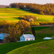 Home and barn on the farm fields and rolling hills of Southern Y — Stock Photo #27066291