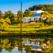 Stock Photo: Barn and trees reflecting in small pond on farm in rural Yor