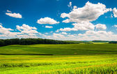 Beautiful summer clouds over fields and rolling hills in Souther — Stock Photo