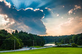 Incredible evening sky over a road and Lake Williams in York, Pe — Stock Photo