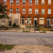 Row houses and cracked sidewalk in Baltimore, Maryland. — Stock Photo #36443899
