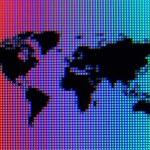 彩虹海洋上的黑色像素世界地图 — 图库照片