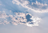 Cloud and sunbeam — Stock Photo