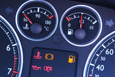 Vehicle dashboard gauges and lights — Stock Photo