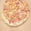 Frozen pizza on a wooden board — Foto de Stock