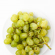 Grapes on a white plate — Stok fotoğraf