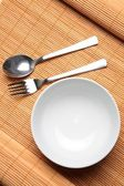 An Empty Bowl with Utensils — Stock Photo