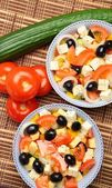 Bowls with Greek salad — Stock Photo