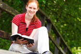 A Woman with a Bible in Her Hands — Stock Photo