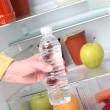 Getting Water from Fridge — Stock Photo