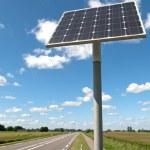 Постер, плакат: Solar panel along a road