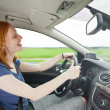 Stockfoto: Careless driver listening to music