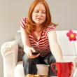 A woman at home, getting a drink — Stock Photo