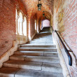 Old stairs under a brick tunnel — Stock Photo