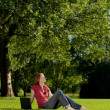 Stock Photo: Woman in an outdoor park with computer