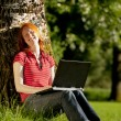 A woman doing homework in the park — Stock Photo