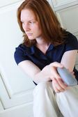 A Sad Woman with a Phone — Stock Photo