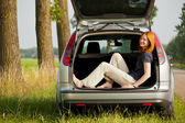Holiday or outing - woman in a car — Stock Photo