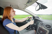 Careless driver listening to music — Stock Photo