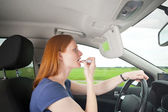 A bad driver - woman putting on makeup — Stok fotoğraf