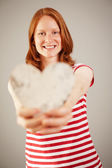 A woman holding a wooden heart — Stock Photo