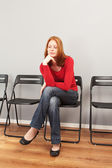 Bored person in a waiting room — Stock Photo