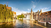 A wide water canal with old buildings — Stock Photo