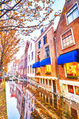 Restaurant and houses near a water canal — Stock Photo